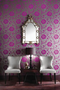 I don't know that I would put this in my house, and I don't know how I feel about the wallpaper. I like the color combo and chairs though!