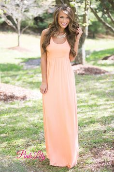 Our bestselling solid color maxis are so versatile and easy to rock in every season! This sleeveless maxi features a racerback, a scoopneck, a long flowing skirt, and an elastic band around the waist. The fabric is also super soft - you'll want to wear it all day long!