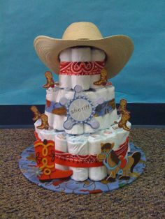 Cowboy diaper cake- the boots, sheriff badge and horse pieces are from Hobby Lobby