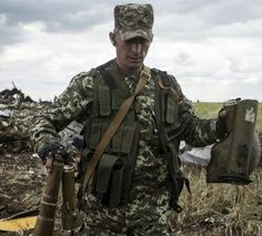 Russian soldiers stealing weapons from a plane they shot down. 49 Ukrainians killed.