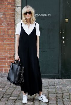 Transition your summer dresses into fall with these stylish outfit ideas for layering T-shirts | /blamefashion/ blogger in white blouse and sneakers, black maxi dress
