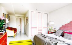 Colorful bedroom with yellow rug