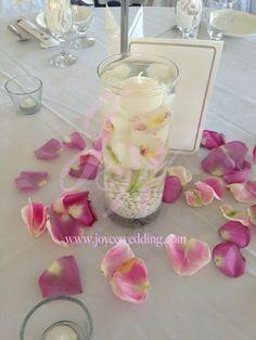#submerge #centerpiece #folding candle #orchid #rose #petals