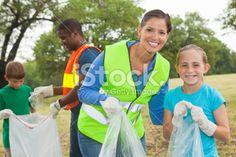 happy; mom; and; daughter   Happy mom and daughter volunteering together/ cleaning up park trash ...