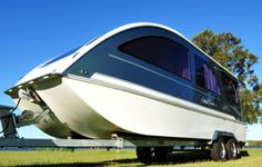 """Caraboat 7500 – an """"all-in-one"""" travel trailer, boat and boathouse with its stylish look and high-end features takes the concept of land and water exploration to the new level."""
