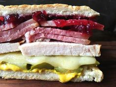 Satisfy Your Fall Cravings With These 12 Awesome Autumnal Sandwiches Thanksgiving Kubanisches Sandwich Croissant Sandwich, Kubanisches Sandwich, Pressed Sandwich, Sandwich Board, Thanksgiving Leftovers, Thanksgiving Recipes, Holiday Recipes, Thanksgiving Wedding, Holiday Meals