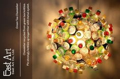 plastic bottle chandelier -- this is actually really neat {it could go well in a teenagers room}