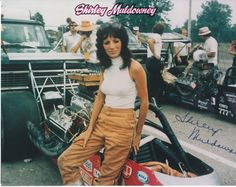 """Shirley """"Cha cha"""" Muldowney, """"First Lady of Drag Racing"""", early Queen Mary in background. Funny Car Drag Racing, Nhra Drag Racing, Funny Cars, Auto Racing, Shirley Muldowney, Women Drivers, Top Fuel Dragster, Thing 1, Dirtbikes"""