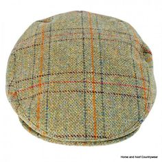 Heather Hats Kinloch Waterproof British Tweed Cap - Light Olive Check The Kinloch is a Teflon coated shetland tweed cap with a waterproof liner Made
