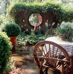 Mirror on this privacy wall brightens up a dark space. It also would reflect lighting, candles on the table, other beauty on the patio. How to Use Mirrors in Your Garden Outdoor Mirror, Outdoor Wall Art, Outdoor Walls, Outdoor Spaces, Garden Buildings Direct, Garden Mirrors, Colorful Frames, Bright Paintings, Solar Powered Lights