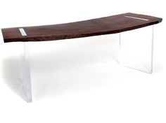Reclaimed Wood Floating Desk An elegant and cool solution for the home office, Rotsens Reclaimed Wood Floating Desk is handcrafted using a single slab of reclaimed wood and legs made of clear acrylic. The use of a naturally curved solid wood top makes this desk even more appealing.