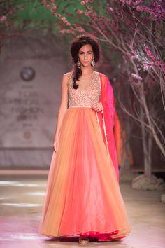 Pink and orange Indian wedding bridal dress by Jyotsna Tiwari. More here: http://www.indianweddingsite.com/bmw-india-bridal-fashion-week-ibfw-2014-jyotsna-tiwari/