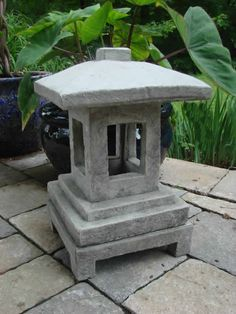 The Mondus Contemporary Lantern, with its clean lines and concrete design is very reminiscent of an Asian shrine. It stands off the ground on concrete legs. Japanese Garden Lanterns, Japanese Stone Lanterns, Japanese Garden Design, Bali Garden, Pagoda Garden, Garden Art, Cement Art, Meditation Garden, Small Gardens