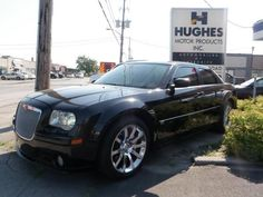 2006 Chrysler 300 SRT8. Chrome Wheels, Heated Mirrors, Power Windows, Privacy Glass, Rain Sensing Wipers, Rear Spoiler, Sunroof,  A/C, Adjustable Steering Wheel, AM/FM Stereo, Bucket Seats, Cassette, Climate Control, Leather Seats, Leather Wrapped Steering Wheel, Pass-Through Rear Seat, Power Driver Seat, Power Passenger Seat, Power Steering, Rear A/C, Seat Memory, Traction Control, Trip Computer   Hughes Motor Products | Toronto | 416-252-1100 | info@hughesmotorproducts.com