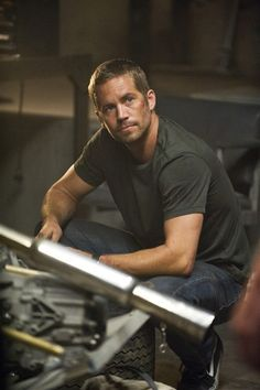 """Paul Walker appears in a promotional still from the film """"Fast Five."""" youll always b in our hearts ;,((("""