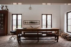 #rustic and traditional residence #dining_room in Fitch bay, Quebec #brick_floor