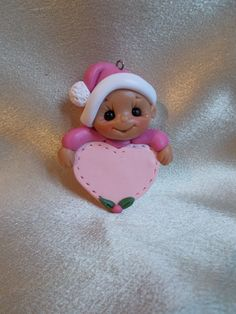 toddler baby girl child Christmas ornament pink heart keepsake personalized polymer clay. $12.95, via Etsy.