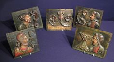Rare collection of five Tudor oak and polychrome PORTRAIT PANELS. ENGLISH-CIRCA 1540.  A KNIGHT, A GENTLEMAN, A LADY AND A SCHOLAR FLANKED BY DOLPHIN SCROLLS, FOLIAGE AND A CHALICE. EACH WITH A HOLE FOR SUSPENSION.