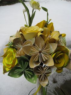Paper bouquets? YES! Poppies, daisies... Oranges/greens.  Just daisies for the girls? Poppy for John, daisy for boys?