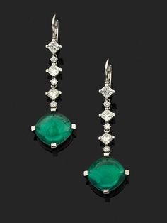 A pair of emerald, diamond and 18k white gold ear pendants, accompanied by Idar-Oberstein certificate stating that the 6.80 and 7.43 cts emeralds, origin Madagascar, shows minor clarity enhancement.