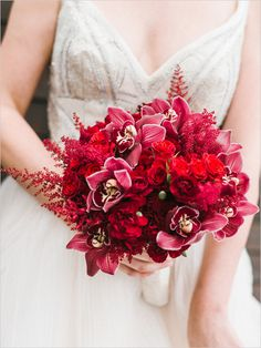Exquisite Wedding Bouquet Arranged With: Red Cymbidium Orchids, Red Astilbe & Several Varieties Of Red Roses + Spray Roses