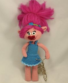 This is a Troll Poppy (from trolls movie) crochet amigurumi pdf pattern . Size is approximately 22 cm.
