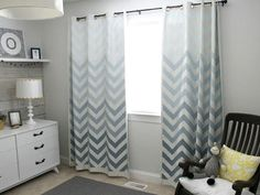 Plain white IKEA curtains are upgraded with four different shades of paint.