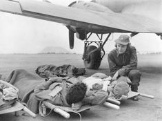 Flight Nurse and Wounded  by Dickey Chapelle