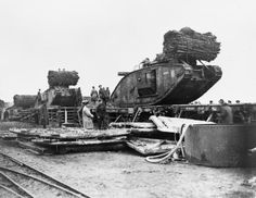 WW1: British Mark IV Female Tanks being loaded aboard flat-bed railway trucks at Plateau Station in preparation for transportation to the forward area prior to the opening of the Battle of Cambrai, Nov 1917.