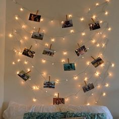 Using clothespins to hang pictures and Christmas lights. Might do this in my dorm room. If I can find Christmas lights