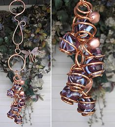 Dragonfly Wind Chimes Glass Copper Garden Art Lawn Ornament Windchime Violet Swirl. • 5.5 inches long • 10 inches total length with hook • Seven 1/2 inch glass orbs • Hand sculpted copper (semi-precious metal over 99% pure) A whimsical copper top created with a circle and spiral combination, adorned with a copper dragonfly. Completed with seven shimmering 1/2 inch diameter violet swirl glass orbs nestled in solid hand-sculpted copper. As a special finishing touch, little copper bells that...