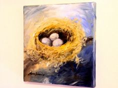 Nest original oil painting on canvas of woodland bird nest and three  bird eggs inside is colorful wall nature art titled Woodland Nest by  Laurie Rohner.   A nest sitting on a branch with the deep blues of  the sky and clouds is a colorful contrast to the rich tones of the  golden yellows of the nest. I love the energy in this painting, with the  softness of the nest almost disappearing into the clouds with the  intensity of the deep blue sky. One of my favorite things to paint is  nature…