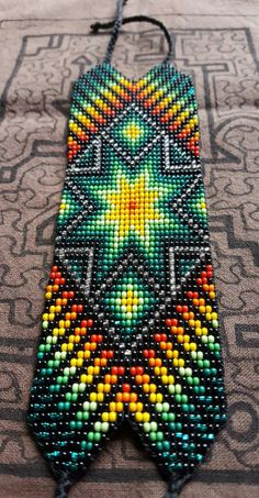 Star of Creation Thick Bracelet 31 bead Colombia Supernatural Style Seed Bead Art, Seed Bead Jewelry, Beaded Jewelry, Bead Loom Patterns, Beading Patterns, Cross Stitch Patterns, Glass Bead Crafts, Resin Crafts, Beaded Braclets