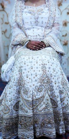 "Gold & White wedding gown - ""Portrait of a Muslim Bride"" by AH Portrait Photography i just love the detail. Indian Bridal Lehenga, Pakistani Bridal, Red Lehenga, Lehenga Choli, Desi Wedding, Wedding Attire, Wedding Dress, White Wedding Gowns, White Bridal"