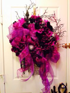 Halloween Wreath Gothic..I created this Halloween for my parents front door...it's full of purple n black roses, glitter silver skulls n black Ravens from the DT...mesh ribbon glitter ribbon from HL...it's Screams HALLOWEEN..!!