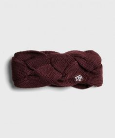 This earband from Adidas is made of knitted bands braided together and in a loop to keep your ears warm.