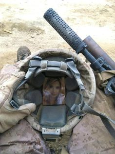 <3 my hubby did the same thing with my picture.He still has my picture in the plastic he had it in when he was deployed to Iraq