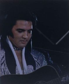 Elvis wearing the Blue Silver Phoenix jumpsuit. Unknown location. June, 1975.