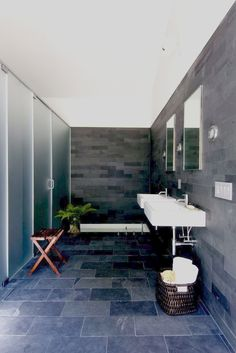 Sunken bathtub with slate floor and wall tile surround  [Texas Hill House by Inc Architecture and Design]