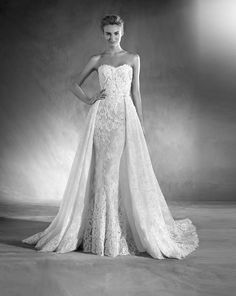 Atelier Pronovias 2017 - An ultra-feminine sweetheart neckline wedding dress in a figure flattering mermaid silhouette with intricate details of Chantilly, lace and glittering gemstone embellishments, featuring a detachable over skirt for extra touch of elegance.Available at Designer Bridal Room, Hong Kong 婚紗