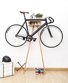 The Sy1t Bike Wardrobe is a unique and modern furniture design and concept. Bike Rack is made from solid alder and acacia wood. The clever design keeps the bike clean and shining by keeping it off the ground – up and away.