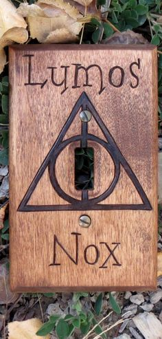 Harry Potter Dealthy Hallows: Lumos/Nox Light Switch Cover -- I would put this in my Library for sure!!