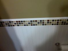 Glass tile trim with bead board.