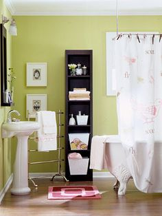 tall narrow dvd shelves in the bath - perfect storage solution  i will need 2 for our bathroom update!
