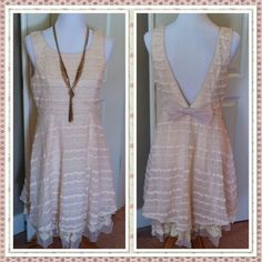 CREAM LOW BACK BOWTIE DRESS -  SMALL So dainty and so flirty; so perfect for Spring. Gorgeous textures and layers of cream lace, chiffon, and crochet trim make this an exquisite Spring dress. S ( 2-4) M (6-8) L (10).  Size SMALL. PRICE IS FIRM, UNLESS BUNDLED. A'reve Dresses