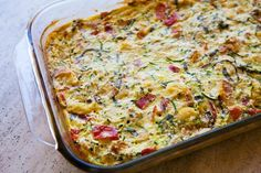 """Zucchini Casserole  3c shredded zucchini  1c Bisquick  1/2c minced onion  1clove minced garlic  1/3c veg. oil  3 large eggs, beaten  1/2c Parmesan cheese  2T parsley, minced  1 tsp seasoned salt  1/2tsp oregano  dash pepper  Mix all ingredients...pour into a 9x13"""" sprayed baking dish  and bake until brown and set about 45 minutes at 350"""