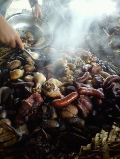 Chilean curanto, seafood with meats cooked among hot rocks.