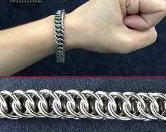 If youre looking for something a little more hardcore than our standard array.. look no further! The Amazing Stan is ever-ready with that pair of pliers and has been working hard learning new weaves...    This heavy-duty stainless steel bracelet is almost an inch wide and features a flat foldover weave called Kings Weave, Kings Scale, and sometimes even the Garter Belt. Despite that last nickname, this hardcore bracelet is not for the faint of heart! Far from delicate, this bracelet is made…