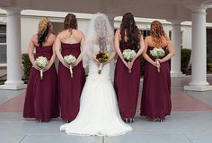 bridal party pose with flowers