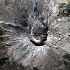 A satellite image of the summit of the Mount St Helens volcano, in Skamania County, Washington State. The summit crater was formed during a massive volcanic eruption on May 18, 1980, following months of volcanic activity.